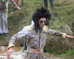 Balclutha resident Ben Cameron, dressed as Elvis Presley as one of the ``Filthy Fathers'',...