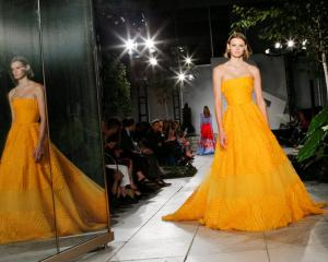 Herrera stayed true to her glamorous and feminine silhouettes, bright hues of red, iris and yellow. Photo: Reuters