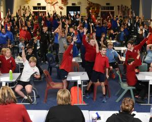 Year 5 and 6 pupils raise their hands to answer a question during the Otago Daily Times Extra! Otago current events quiz. Photos: Gregor Richardson