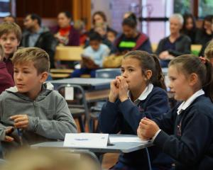 Sacred Heart pupils (from left) Sean Newlands, Maddy Holden and Anastasia Burrell (all 10) take part in the quiz. Photo: Greta Yeoman