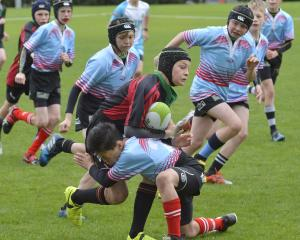 Canterbury Metro under-48kg flanker Noah Dunnage (left) and winger Tom Harrison tackle Otago...