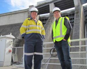 Roxburgh Dam generation technician Roger Calverley (left) and Contact Energy head of hydro...