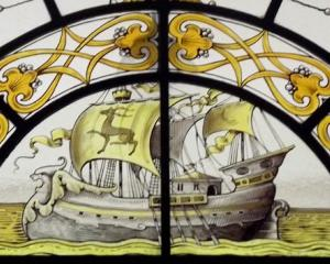 Examples of the ship designs featured in several stained glass windows at Olveston, symbolising...