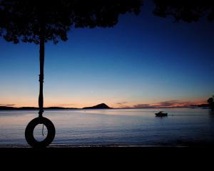 The sun sinks into the Hauraki Gulf at Long Bay Motor Camp. Photos: Jeff Kavanagh