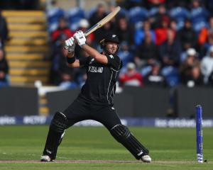 New Zealand batsman Corey Anderson smashes the ball through the offside during the Champions...