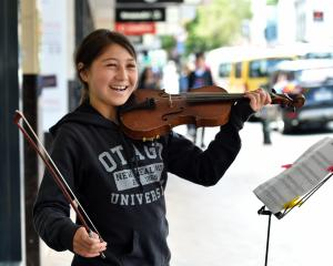 Serenity Hook, of Dunedin, entertains pedestrians in George St yesterday. Photos: Peter McIntosh
