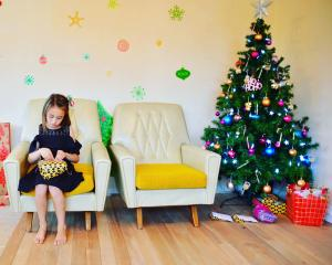 Bailey-Ray Chapman (8) opens a present on Christmas Day. Photo: Sarah Williams