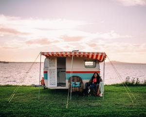 Having rescued her from her intended undignified final resting place - she was to be buried in a ditch on a Taranaki farm - Mieke completely rebuilt Claris the Retro Caravan from the bones up. Photos: Sam Stuchbury