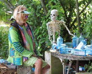 JJ Rendell and a gin-loving skeleton are set for a garden party. Photos: Hamish MacLean