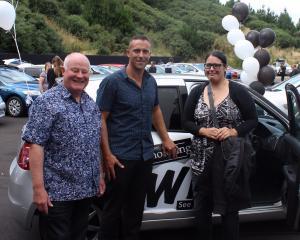 Vince and Josh Jones congratulates Kerri-Lee Smith, winner of the $8000.00 Suzuki Swift.
