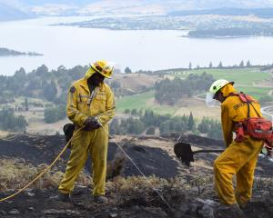 Fire officers Joe Natuikata and Johnathon Moate, from Gore volunteer fire brigade, high up on Mt...