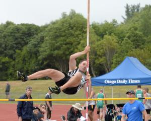Bruce Solomons, competing in the decathlon pole vault, clears a height at the Caledonian Ground...