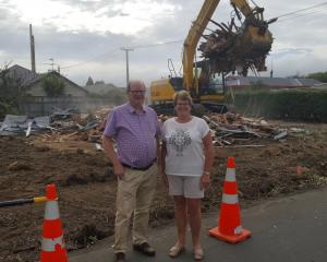 Siblings Bill Feather and Janice Pont stand in front of the demolished house in High St. Photos: Supplied