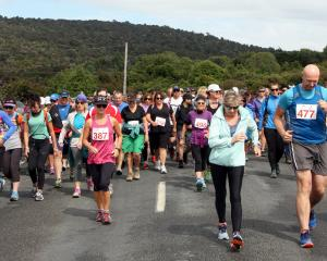 The walkers head off on their 15.5km walk in  the Papatowai Challenge on Saturday. Photos: Glenda...