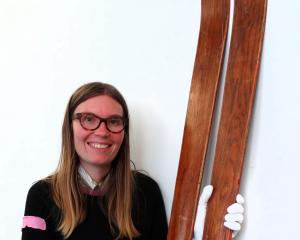 North Otago Museum curator Chloe Searle holds the skis used by Oamaru's Herbie Familton, New Zealand's first winter Olympian, at the 1952 Winter Olympics in Norway. Photo: Daniel Birchfield