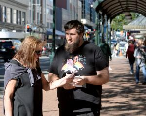 Comedian Dylan Satherley, of Palmerston North, finds a potential audience member in Pamela Jackson yesterday. Photos: Linda Robertson