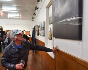 Dunedin artist and exhibition judge Barry Weston looks at photographic work Allans Beach Storm, by John Burke. Photos: Peter McIntosh