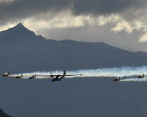 Black Peak dominates the background as the Catalina flying boat, flanked by the RNZAF Black...