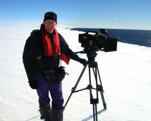 Cameraman Peter Young filming The Last Ocean in Antarctica.