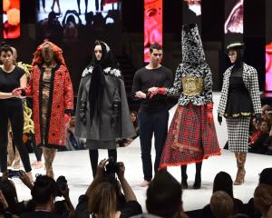 Models wear design creations by 2018 iD International Emerging Designer Award winner and...