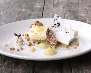 Andy Aitken's work in progress — a Whitestone Shenley Blue semifreddo with bird seed crackers, meringue and walnut praline. Photo: Linda Robertson
