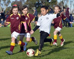 Maori Hill 6th Maroon players  Ava Couling (left), Olivia McIntyre and Alice Ussher try to take...