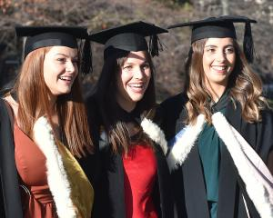 Happy graduates (from left) bachelor of commerce graduate Kelsey Glue (21), bachelor of commerce...