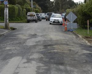 Damage to the road surface in Manapouri St and other areas in Ravensbourne has been labelled a disgrace by West Harbour Community Board deputy chairman Trevor Johnson. Photos: Gerard O'Brien