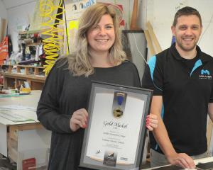 Miller Creative Group signage and sales manager Steph Sykes and signage production manager Dean Turner in the firm's Anzac Ave workroom. Photo: Christine O'Connor