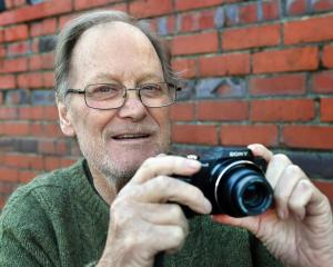 Dunedin poet Peter Olds no longer has his faithful Pentax SLR but uses this compact digital...