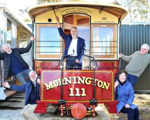 Celebrating the delivery of cable cars to Mornington earlier this year were (from left) Trevor Goudie, Mac Gardner, Neville Jemmett, Claire Goudie and Stuart Payne. Photo:  Christine O'Connor