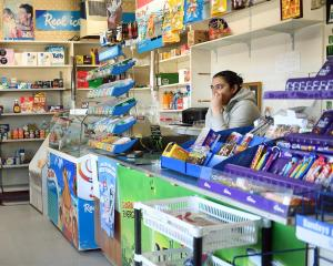 Manjinder Sandhu says she is selling her Prince Albert Rd dairy after the nearby Stadium Store was targeted in a brazen theft by two masked offenders who remain on the run. Photo: Stephen Jaquiery