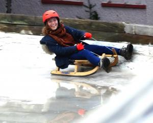 Tres bien! Marine Fossier, of France, enjoys the luge as part of her time as an exchange student...