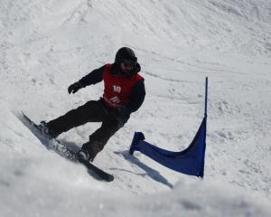 Ross Whitelaw, of Wanaka, swoops round another gate during the banked slalom competition. Photos:...