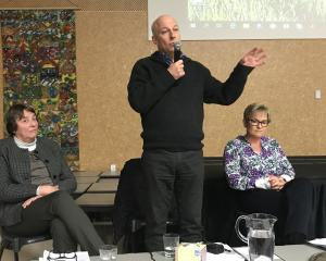 Dr Marion Poole (far left) from the Southern District Health Board and lawyer Jayne Macdonald look on as Destination Queenstown chief executive Graham Budd addresses the Frankton Community Association meeting. Photos: Daisy Hudson