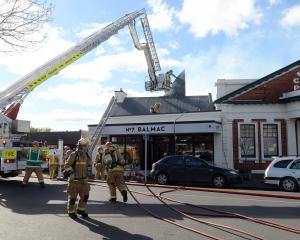 Firefighters rip open the roof of popular Dunedin restaurant No7 Balmac to battle a blaze there...
