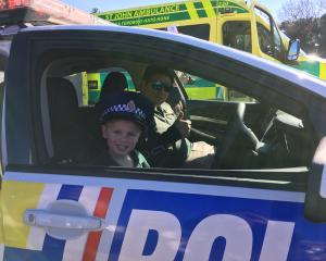 Laikyn Triggs (4), of Temuka, takes the wheel of a police car while her dad, Brad (a driver for...