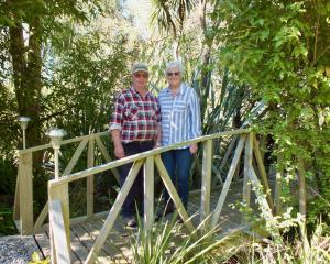 Margaret and Barry Sloper on the wooden bridge Barry built. Photos: Gillian Vine