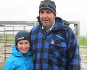 Kaeley Young (11) and her dad Brian, both of Gore, enjoyed finding out what was going on at the Southern Dairy Hub during its recent field day. Photos: Yvonne O'Hara