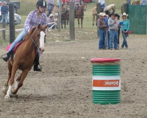 Jasmine McLeod, of Chatto Creek, concentrates as she takes part in the local barrel race. Photos:...