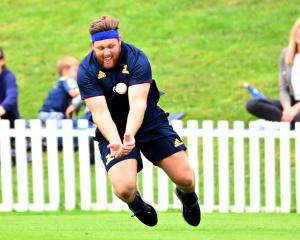 New Highlanders prop Ayden Johnstone cannot hang on to a catch in the outfield. Photos: Peter...