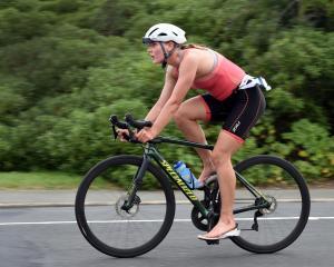 Women's winner Cecilia Crooks, of Dunedin, on the cycling leg. Photos: Peter McIntosh
