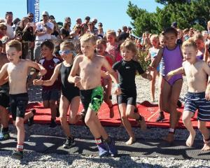 A group of year 4 pupils take off at the start of the challenge; there was not much between this group of year 4 athletes when they exited the water. Photos: Sean Nugent