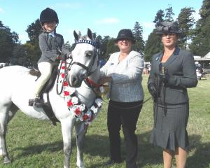 Olive Grove (7), of Temuka, who won the lead rein and first ridden, with judge Sandy Mardell (middle) and mother Sarah Cronin. Photos: Chris Tobin.