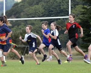 Year seven competitors take off from the starting line during the Dunedin primary and...