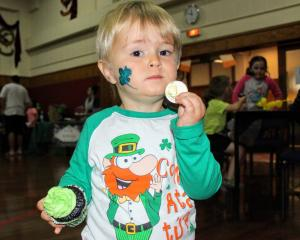 Ted Butson (2) enjoys some Irish themed baking. PHOTO: LUISA GIRAO