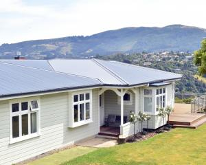 A year-long renovation has transformed this Dunedin property from how it looked originally (next...