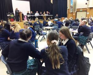 Year 9 and 10 pupils work out their answers at the Otago Daily Times Extra! spelling quiz at...