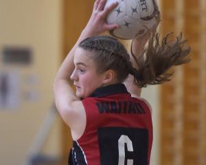 Waitaki Girls' High School centre Sarah Jamieson (13) takes the ball in the match against Queen's...