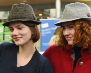Phoebe Fulton (left, 19), of Nelson, and Hannah Priest (20), of Canada, try some vintage hats at...